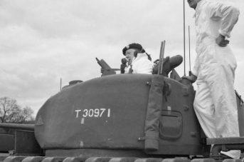 Tom Adair with Winston Churchill on a Churchill tank